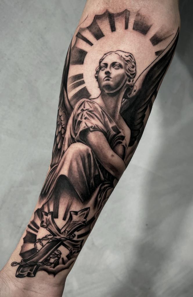 Black and grey angel tattoo
