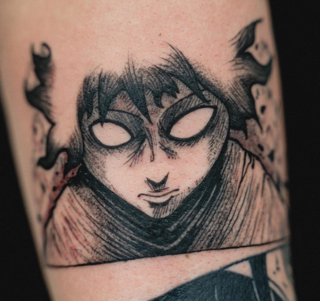 Anime blackwork tattoo