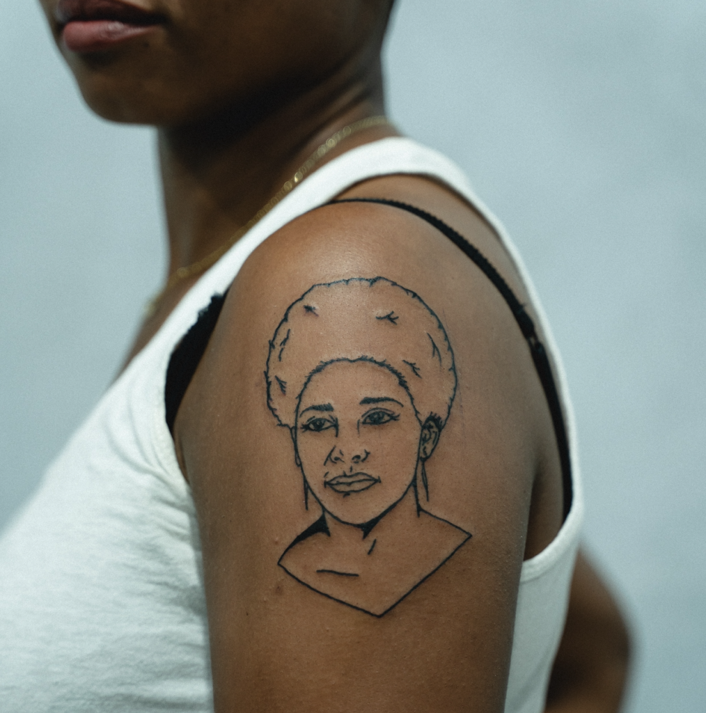 Afro Mom tattoo on dark skin