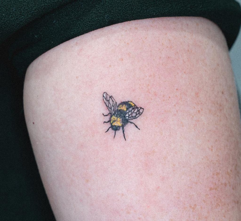 Small tattoo bee