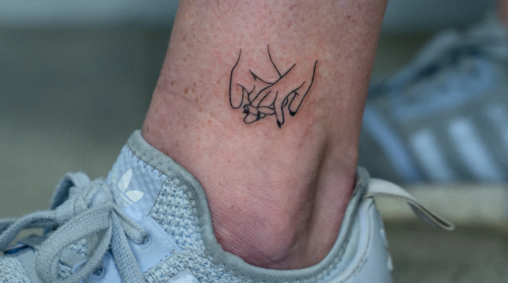 Small tattoo ankle hands