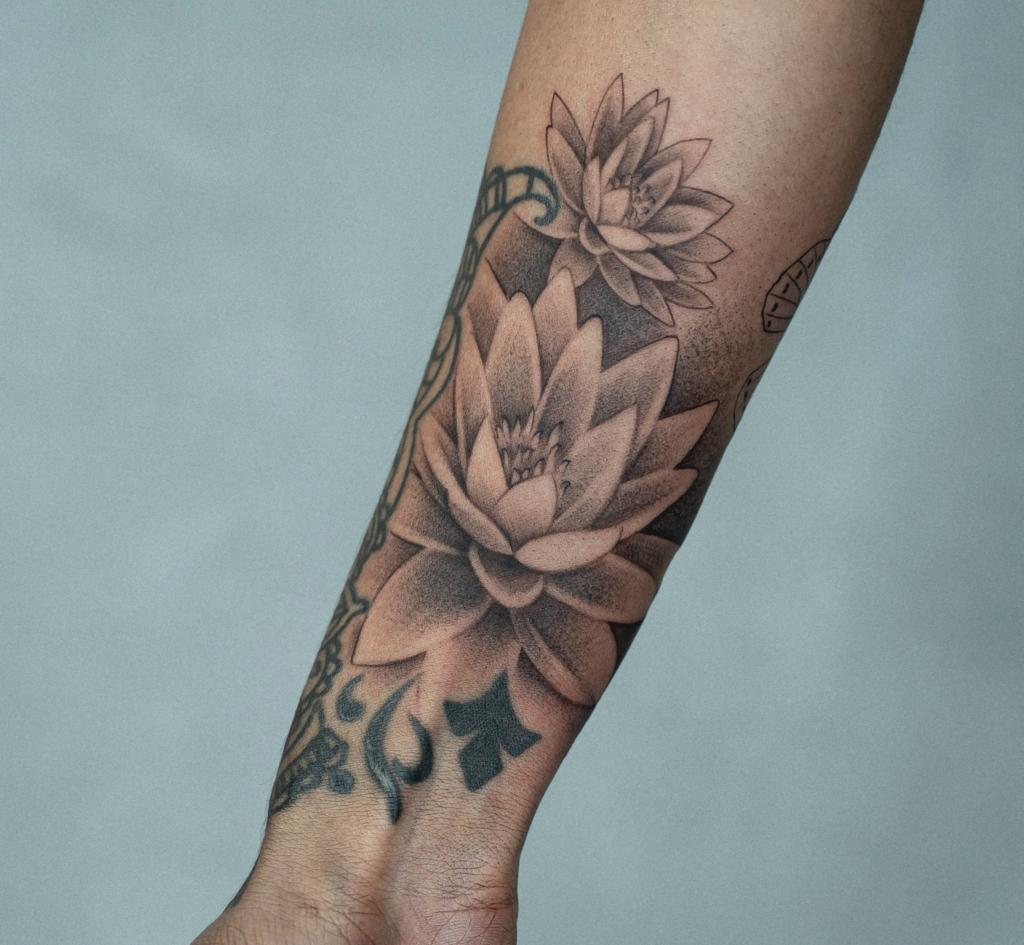 Wrist tattoo lotto flower