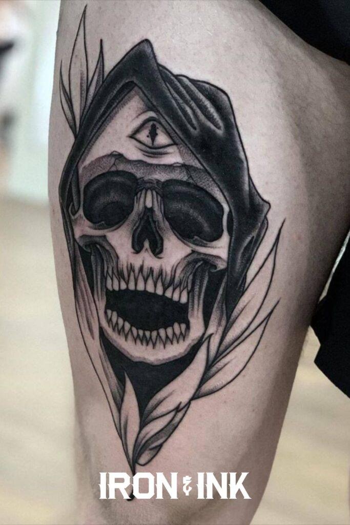 Black and grey death tattoo leg