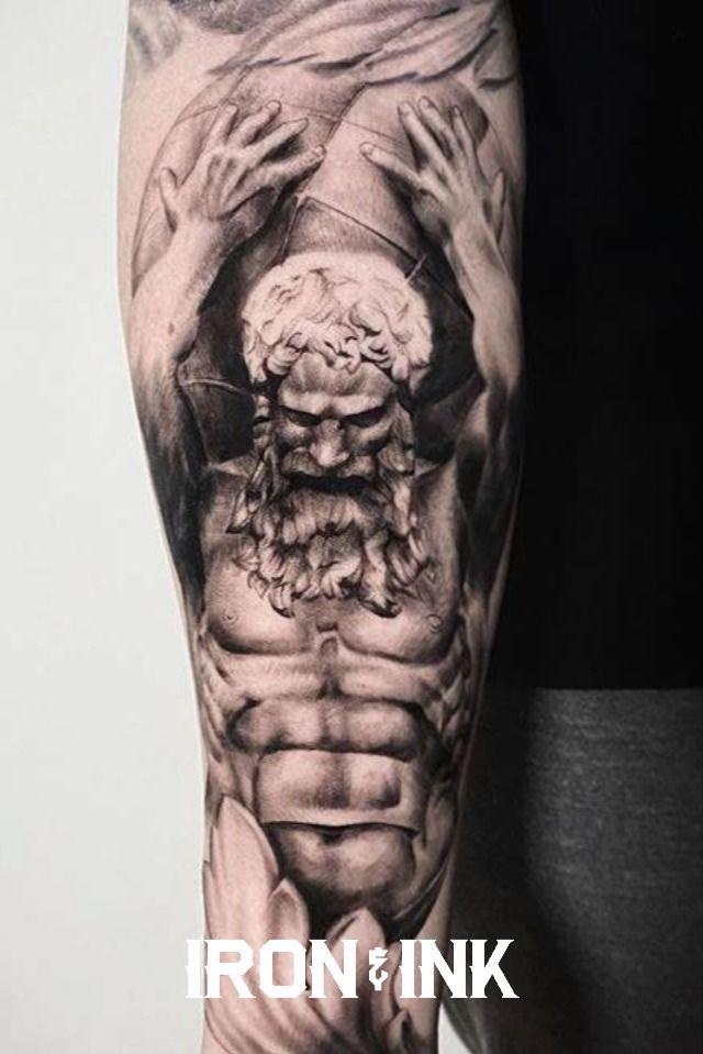 Black and grey realism atlas tattoo arm