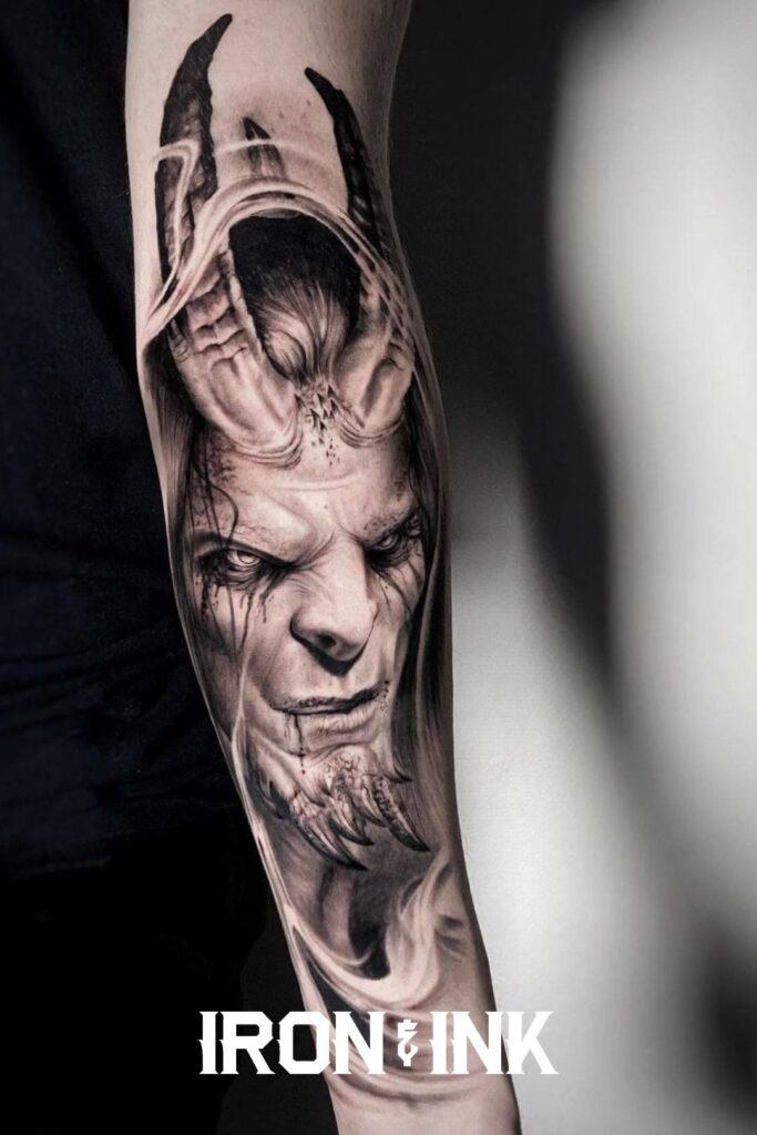 Black and grey realism tattoo demon forearm