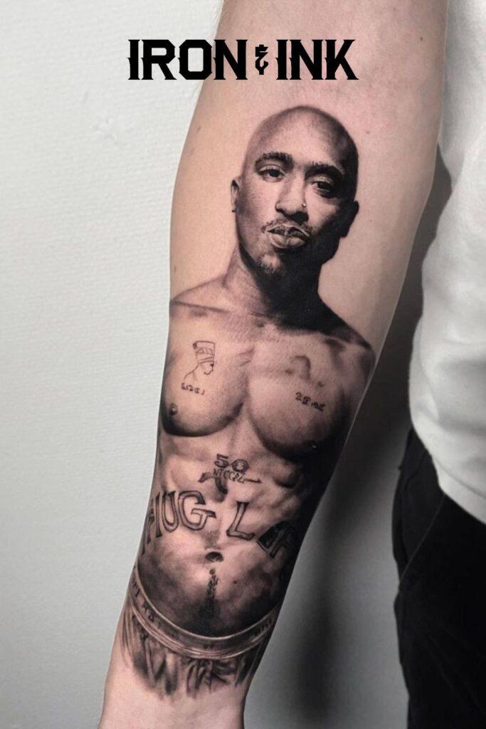Black and grey tattoo realism tupac forearm