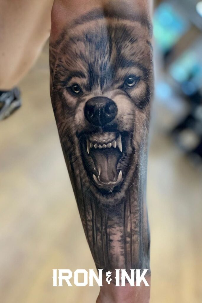 Black and grey realism wolf tattoo forearm