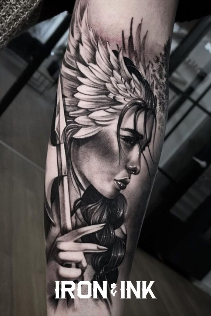 Black and grey woman warrior tattoo forearm