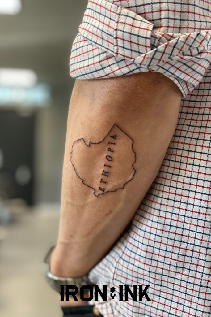 Fine line map tattoo ethiopia