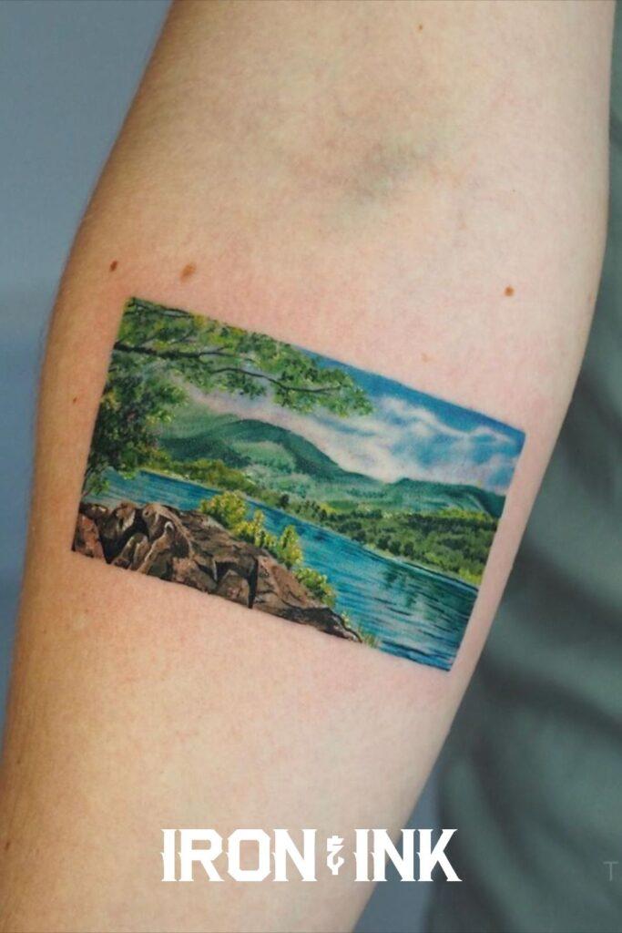 Minimalistic colour realism nature tattoo