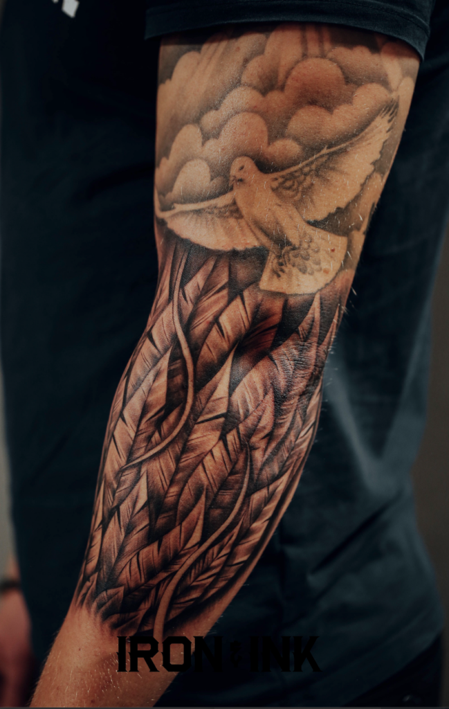 Feather realism tattoo forearm