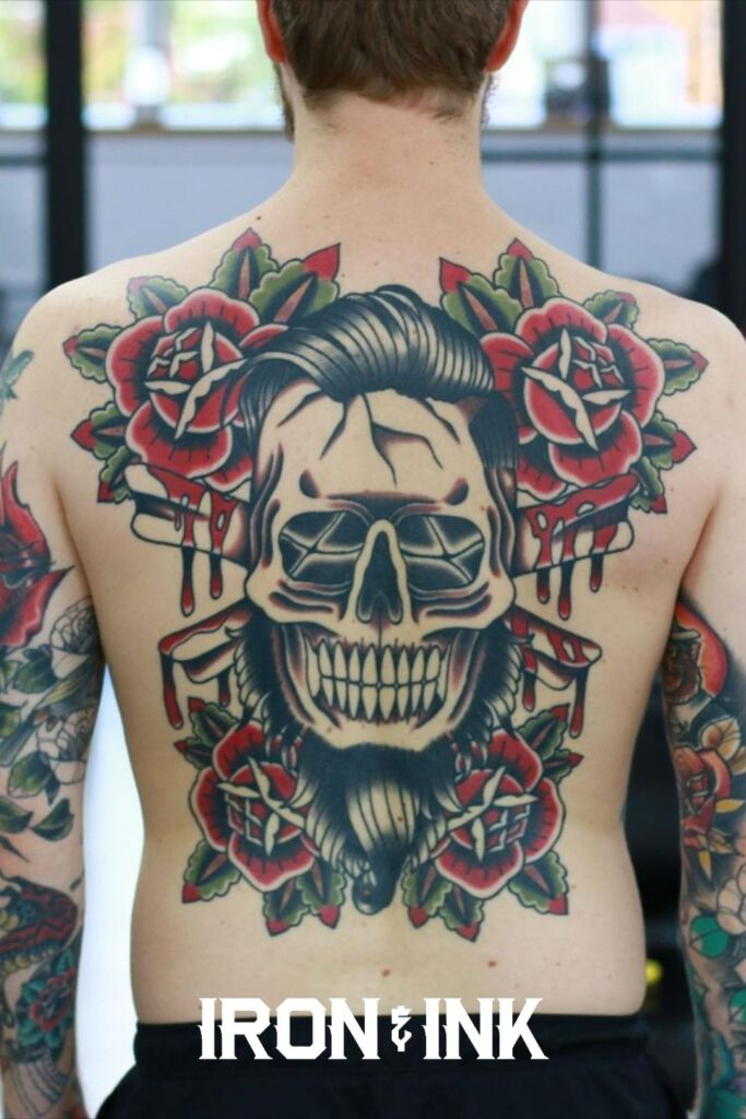 Traditional old school back piece skull and roses tattoo